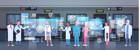 Group Of Medical Doctors Using Digital Monitor - Health/Medicine Conceptual