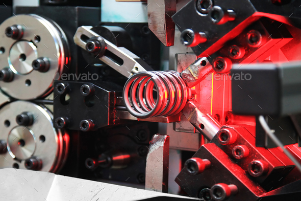 Machine automatic spring coiling - Stock Photo - Images