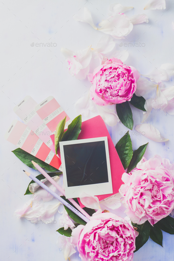 Minimal styled flat lay with peony flowers, blank photo frame and pink notebook. - Stock Photo - Images