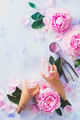 Minimal styled flatlay with peony flowers, petals, and waffle ice cream cones on a pastel background - PhotoDune Item for Sale