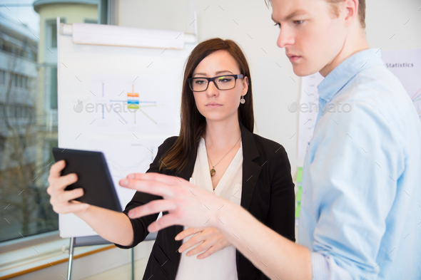 Colleagues Using Digital Tablet In Office - Stock Photo - Images