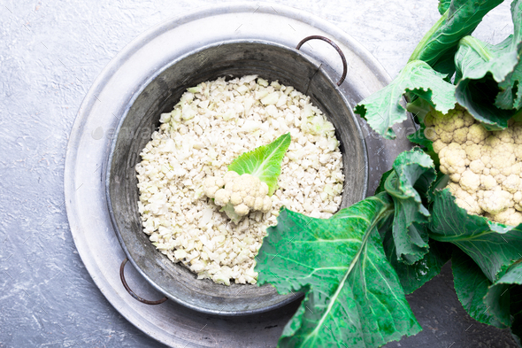 Cauliflower rice in metal bowl on grey background. Top view. Overhead. Copy space. Shredded - Stock Photo - Images