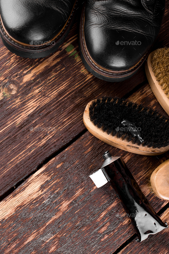 Black boots on wooden background - Stock Photo - Images