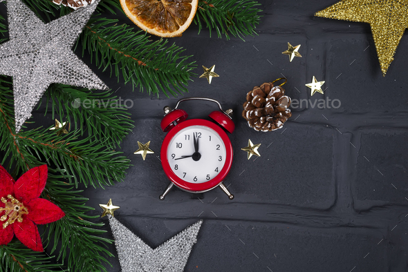 Christmas fir tree with decoration and red clock - Stock Photo - Images