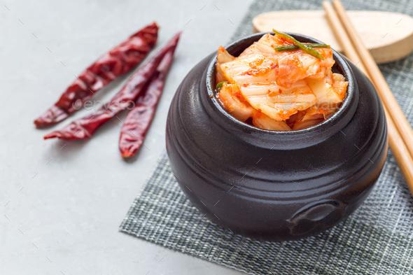 Kimchi cabbage. Korean appetizer in ceramic jar, horizontal - Stock Photo - Images