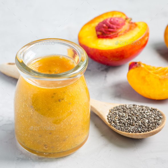 Smoothie with nectarine, orange juice, chia seeds and honey in glass jar, square - Stock Photo - Images