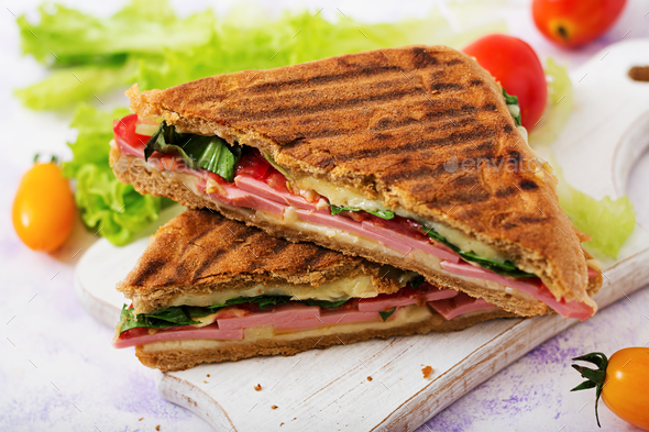 Club sandwich panini with ham, tomato, cheese and lettuce - Stock Photo - Images
