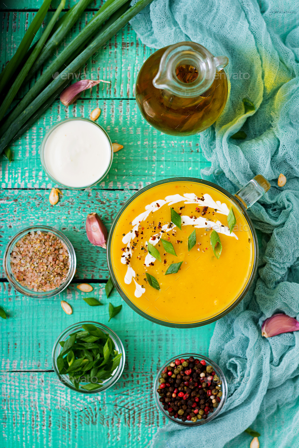 Cream of pumpkin soup with sour cream sauce. Flat lay. Top view - Stock Photo - Images
