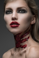 Portrait of young women with makeup and blood on the neck