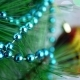 Turquoise Decorative Garland on Christmas Tree with Blur Baubles