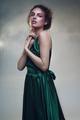 Portrait of beautiful woman in fashion green dress