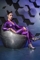 Young woman fantasy violet costume on techno background