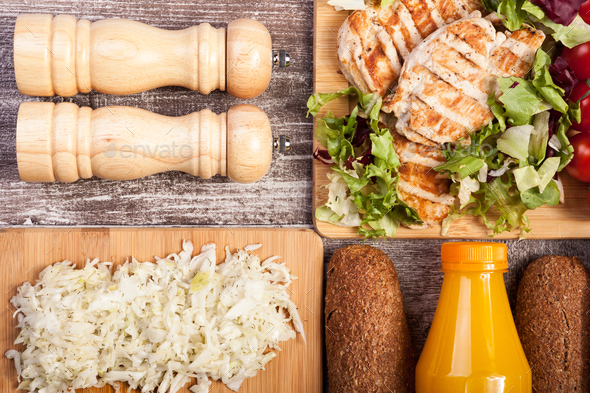 Delicious grilled chicken on wooden board - Stock Photo - Images