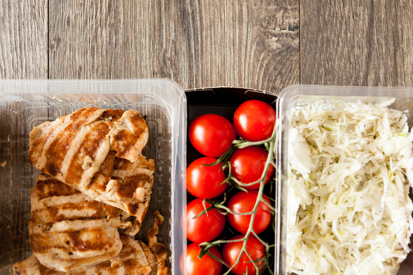 Lunch packed in different boxes - Stock Photo - Images