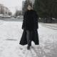 Woman in Black Coat Walking on Street