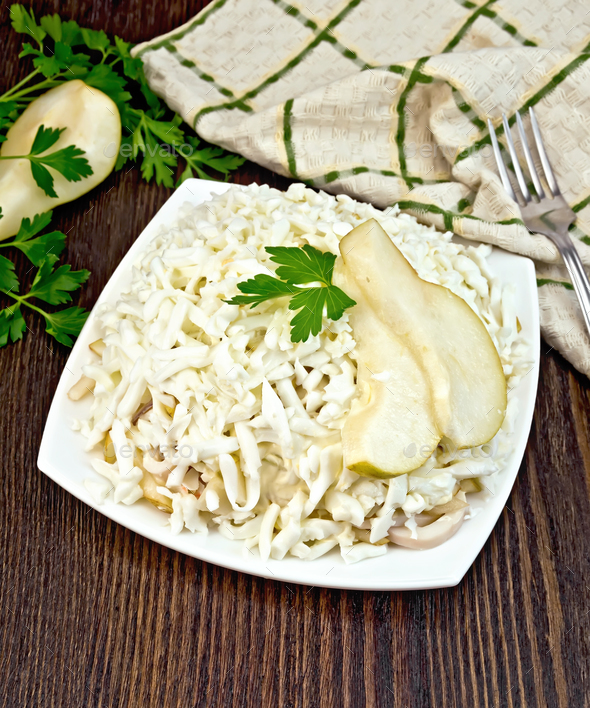 Salad of squid and pears with parsley on board - Stock Photo - Images