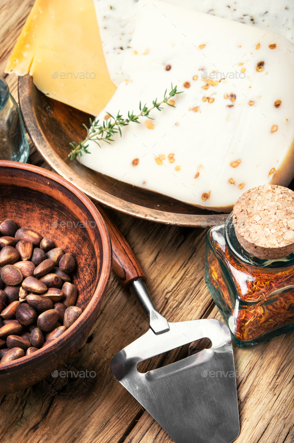 Swiss cheese with pine nuts - Stock Photo - Images