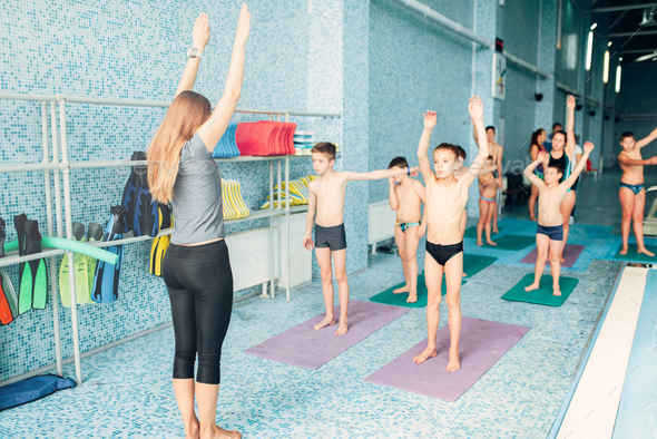 Instructor and group of children doing exercises - Stock Photo - Images