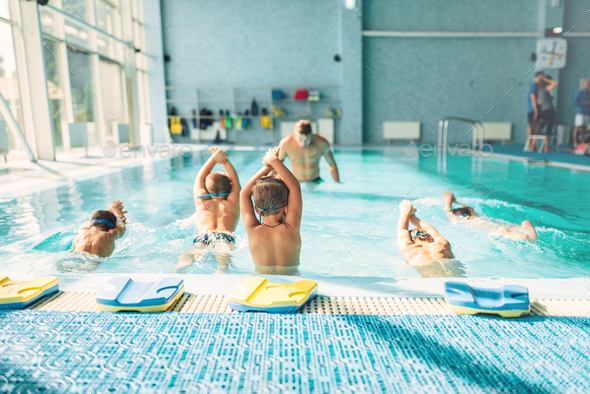 Kids trying to dive in swimming pool - Stock Photo - Images