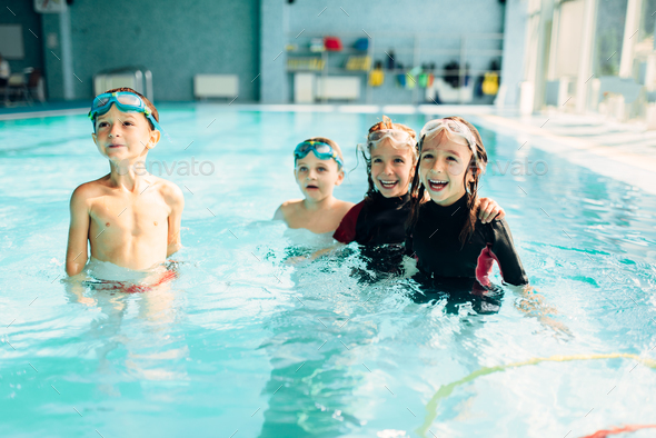 Friendly children with swimming goggles. - Stock Photo - Images