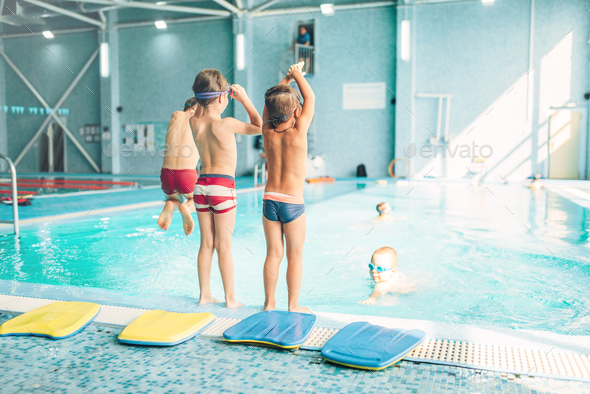 Boys doing sportive exercises with hands up - Stock Photo - Images