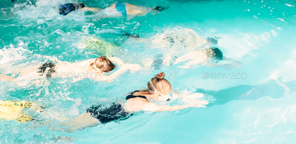 Children swimming underwater in pool - Stock Photo - Images