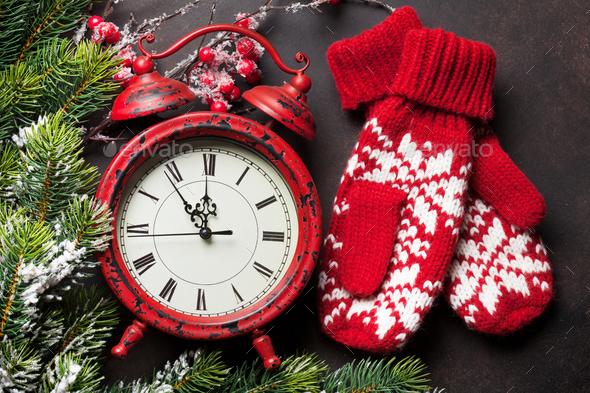 Christmas clock and mittens - Stock Photo - Images