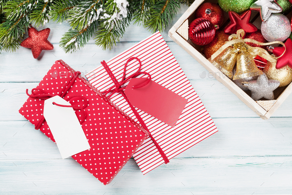 Christmas gift boxes, decor and fir tree - Stock Photo - Images