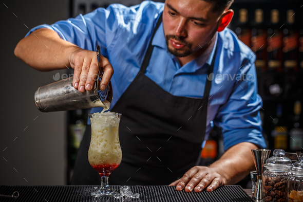 Male bartender is making cocktail - Stock Photo - Images