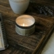 On a Wooden Stand There Is a Candle in the Notebooks and a Flower. - VideoHive Item for Sale