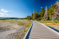 Tourist with backpack hiking in Yellowstone - PhotoDune Item for Sale