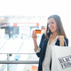 Shopper holding a card - PhotoDune Item for Sale