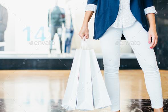 Shopper holding buyings - Stock Photo - Images