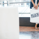 Woman standing behind shopping bag - PhotoDune Item for Sale