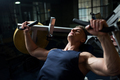 man doing chest press on exercise machine in gym - PhotoDune Item for Sale
