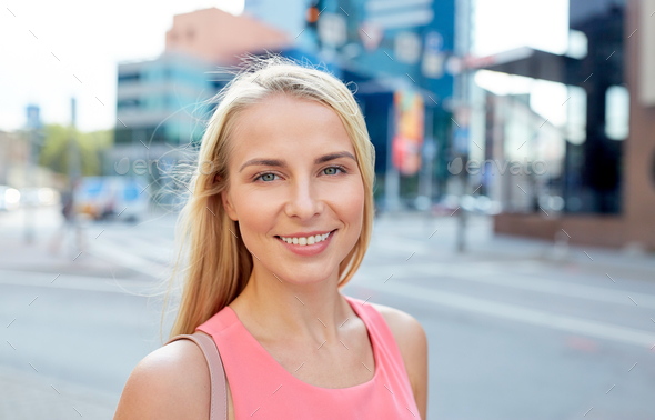 happy smiling young woman on city street - Stock Photo - Images
