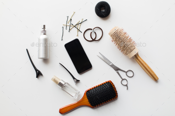 smartphone, scissors, brushes and other hair tools - Stock Photo - Images
