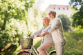 happy senior couple with bicycle at summer park - PhotoDune Item for Sale