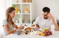 couple with smartphones having breakfast at home - PhotoDune Item for Sale