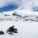 Panorama: Snowy Rocky Mountain and White Clouds on Blue Sky - PhotoDune Item for Sale