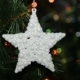 Christmas Toy on a Christmas Tree Against a Garland in the Blur - VideoHive Item for Sale