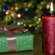 A Lighted Candle and a Gift Box on the Background of a Bokeh - VideoHive Item for Sale