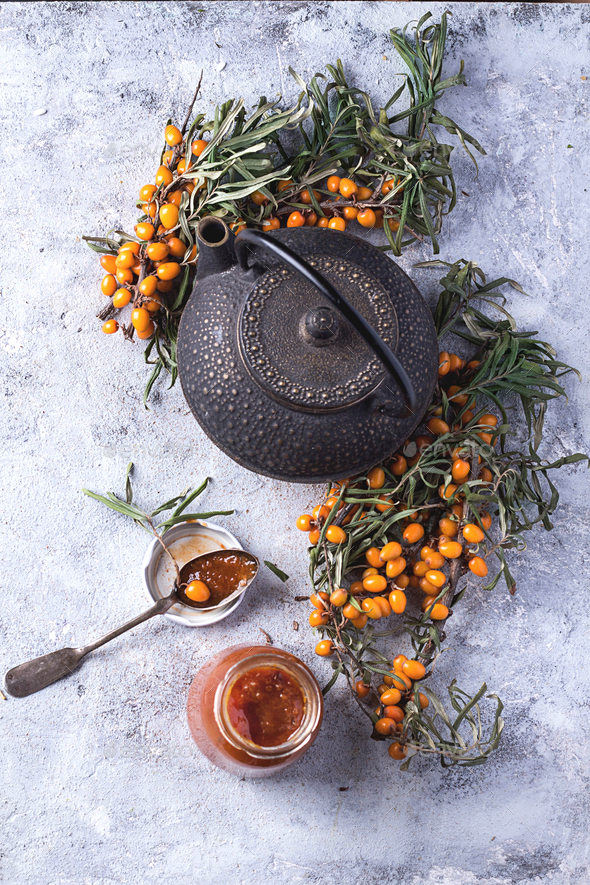 Tea with buckthorn berries - Stock Photo - Images