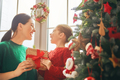 Mom and daughter decorate Christmas tree - PhotoDune Item for Sale