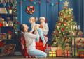 family near Christmas tree - PhotoDune Item for Sale