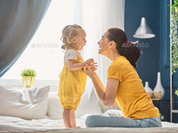 Mom and daughter are playing - Stock Photo - Images