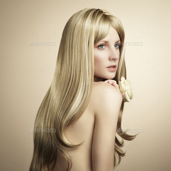Fashion photo of a young woman with blond hair - Stock Photo - Images