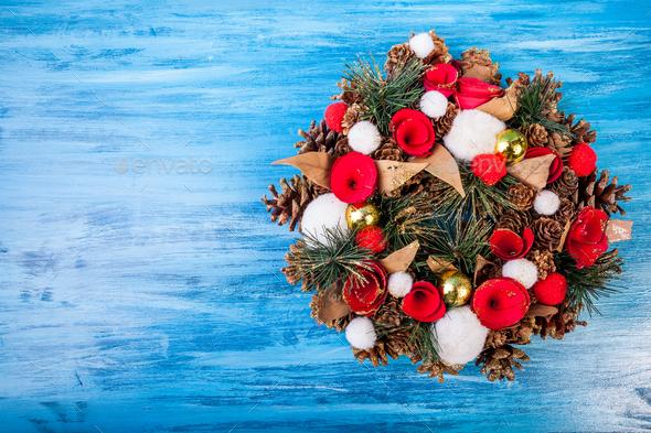 Christmas wreath on blue background - Stock Photo - Images