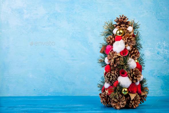 Mini Christmas tree on blue background - Stock Photo - Images