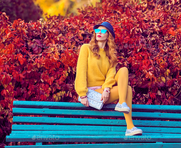 Fall Fashion. Young Woman Sitting on Bench - Stock Photo - Images